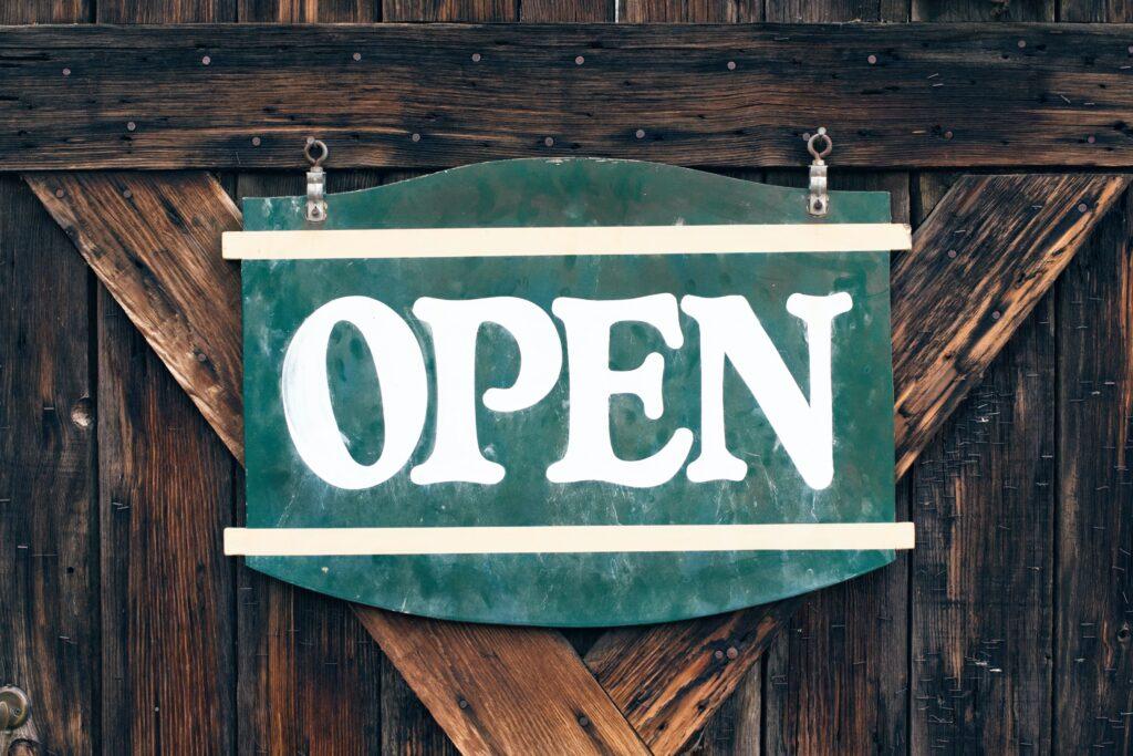open sign on the wooden doors